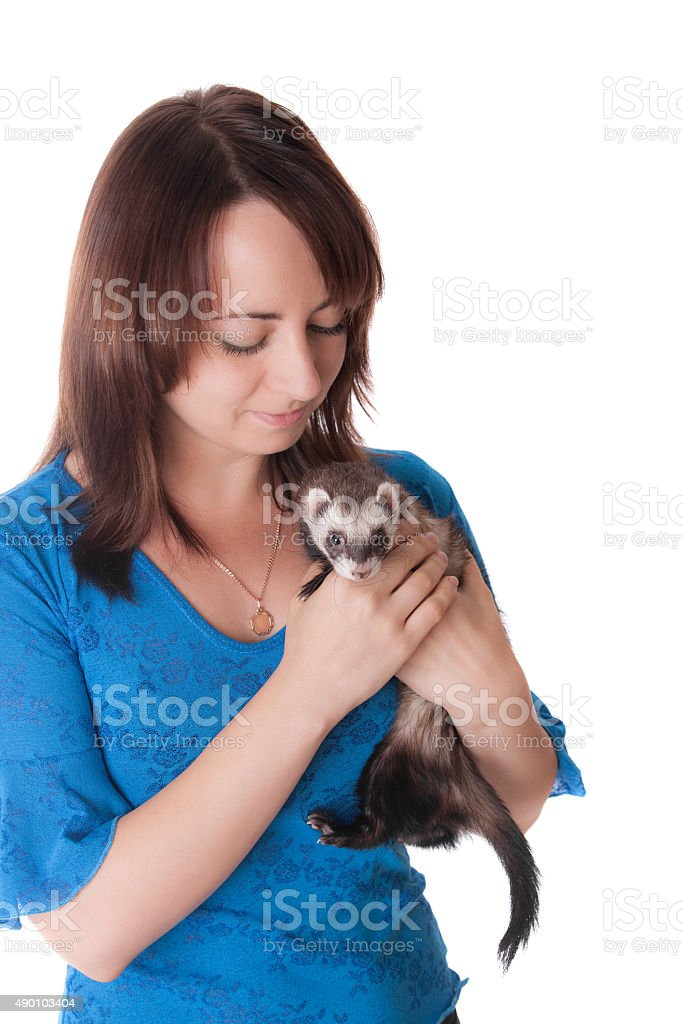 girl with a domestic polecat stock photo