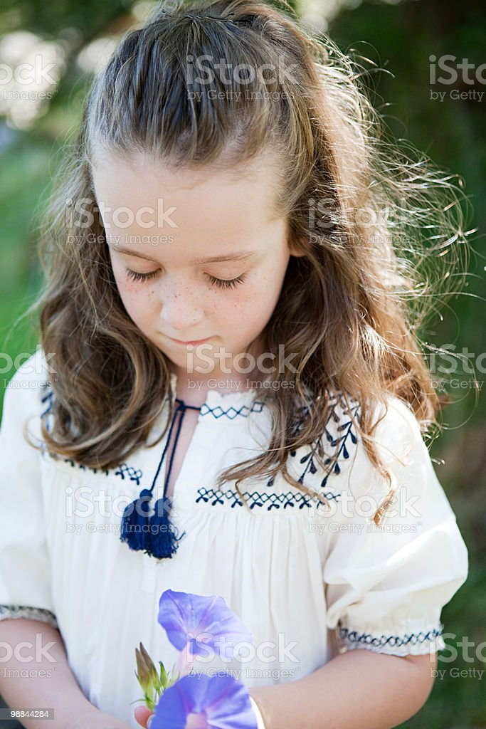 Girl with a flower foto de stock libre de derechos