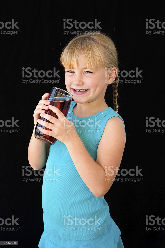 Girl with a glass of juice royalty free stockfoto