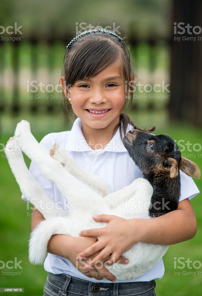 Girl with a goat royalty-free stock photo