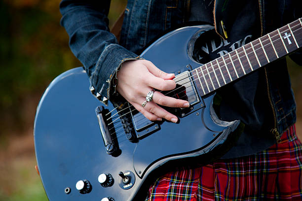 girl with a guitar - punk music stock photos and pictures
