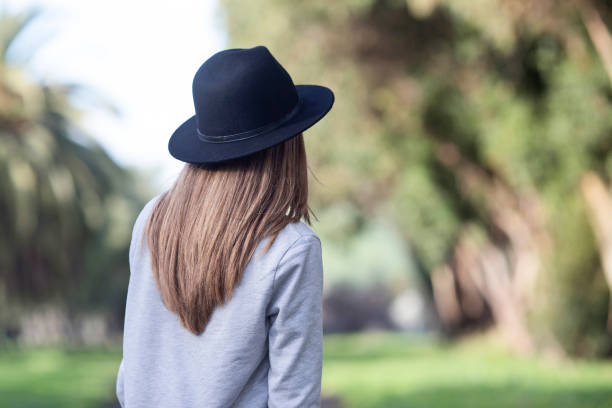 A girl with a hat a girl with a hat on a trail jude beck stock pictures, royalty-free photos & images