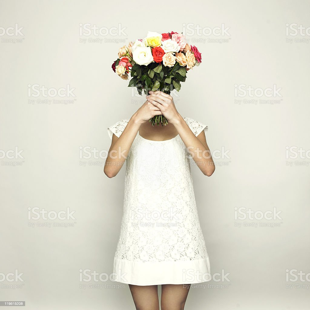 Girl with a head-roses stock photo