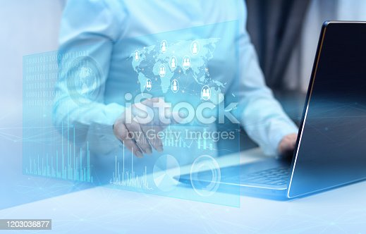 istock girl with a laptop symbolizes develop the Internet and the Internet of things for the interaction of mankind and simplify the life of the population 1203036877