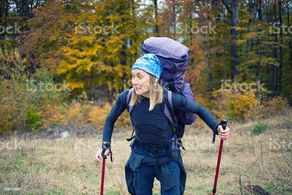 Girl with a large backpack. royalty-free stock photo