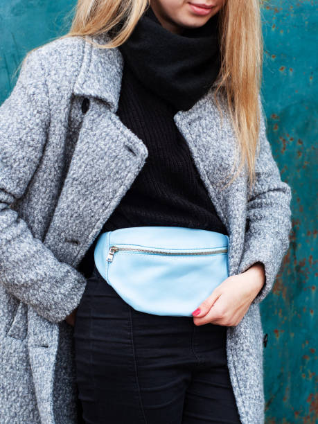 girl with a leather waist bag - waist bag stock photos and pictures