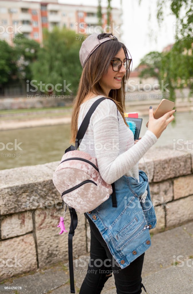 girl with a pattern is enjoying the sun beside the river - Royalty-free Adult Stock Photo