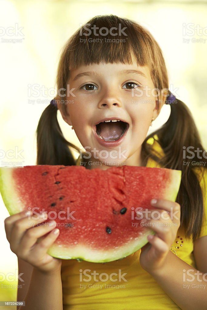 girl with a piece of watermelon royalty-free stock photo