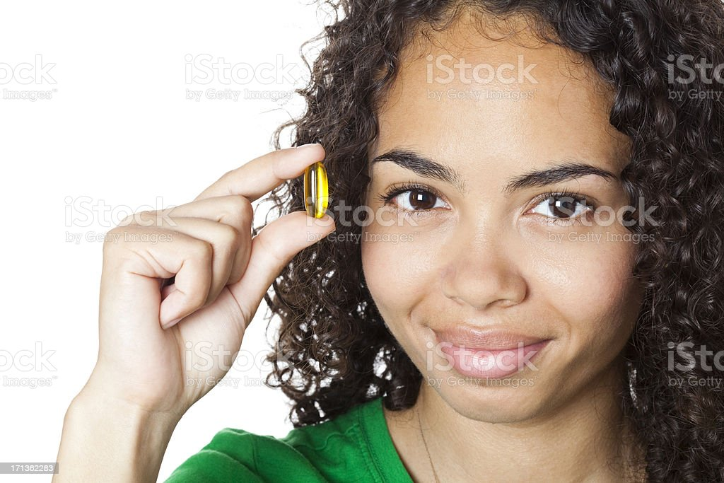 Girl with a pill on white background royalty-free stock photo