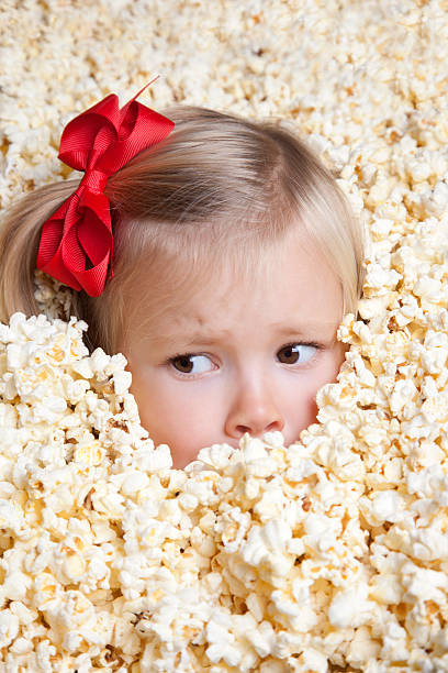 girl with a red ribbon in popcorn - omg stock photos and pictures
