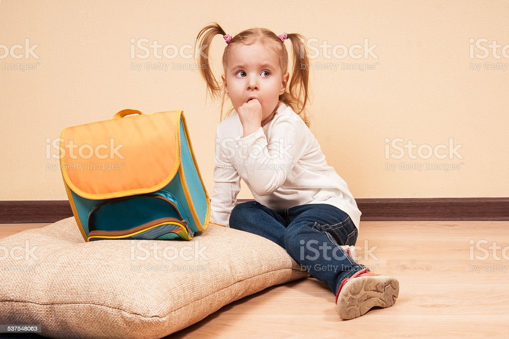 Girl with a School Bag stock photo