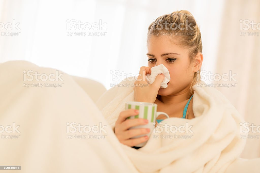 Girl With A Sniffle stock photo