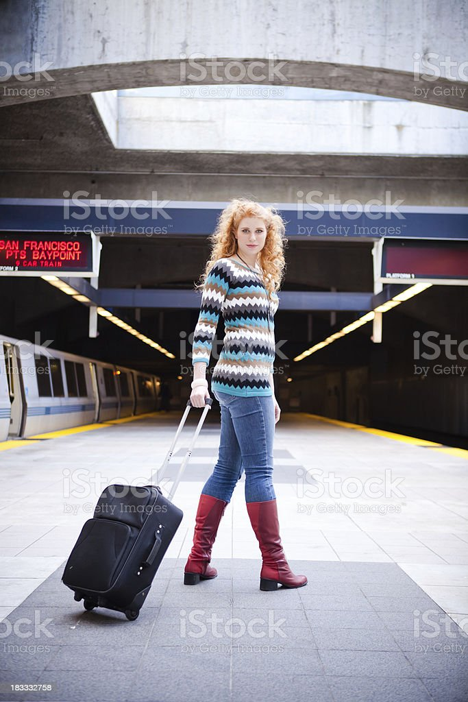 Girl with a Suitcase on Train Platform stock photo