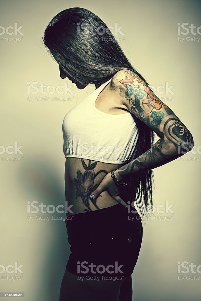Girl with a tattoo royalty-free stock photo