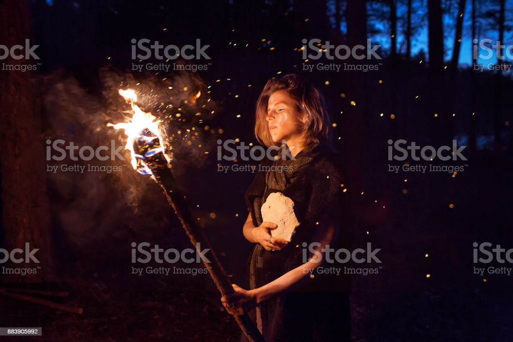 girl with a torch shamanic night stock photo