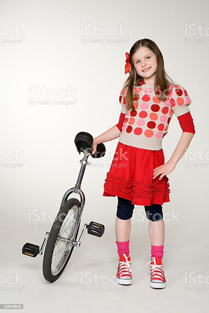A girl with a unicycle 免版稅 stock photo
