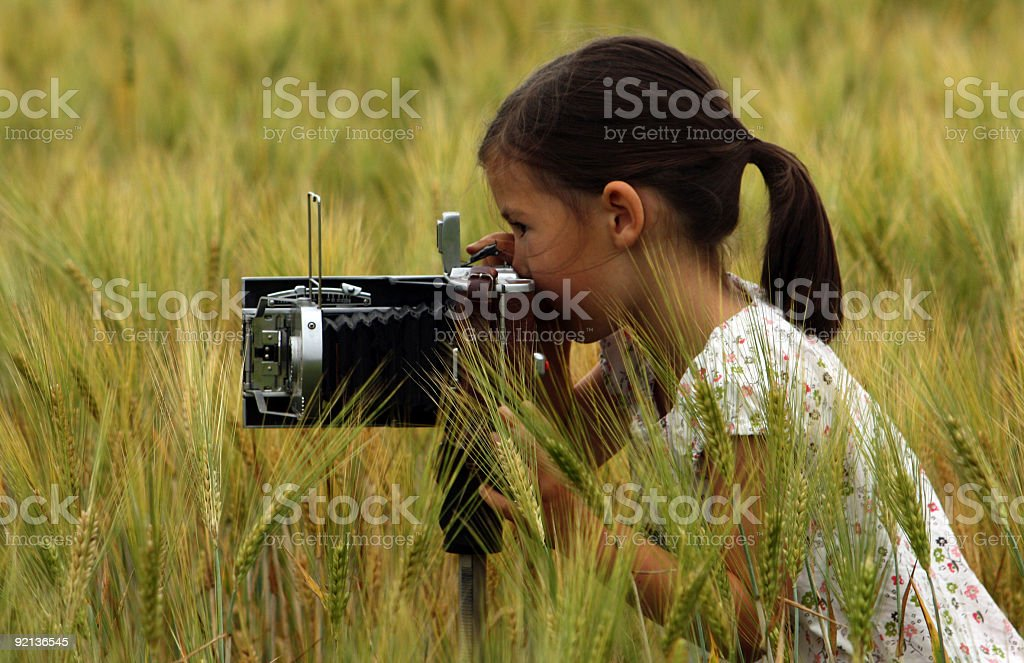 Girl with a vintage camera royalty-free stock photo