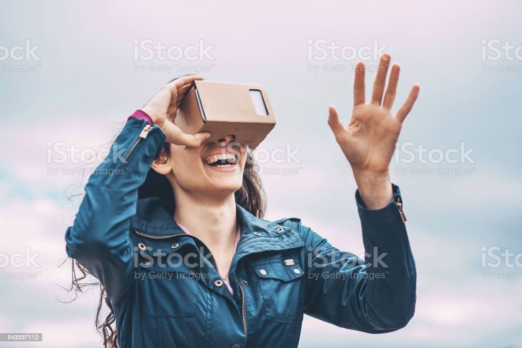 Girl with a virtual reality simulator stock photo