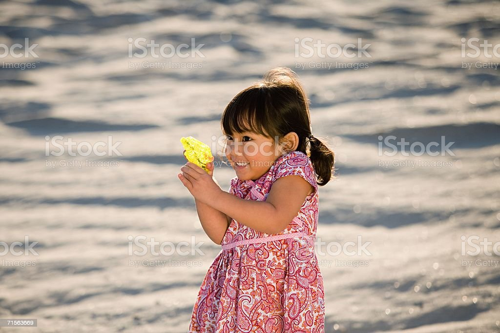 Girl with a water pistol royalty-free stock photo