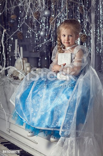 istock Girl with a white book 841048978