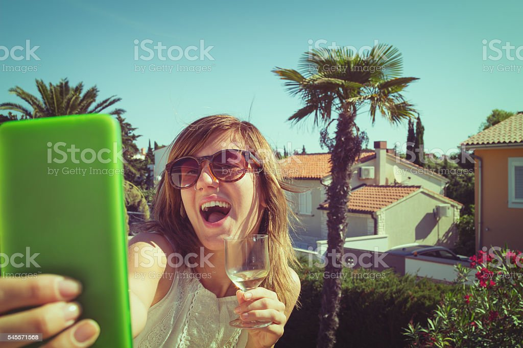 Girl with a wine and cellphone. stock photo