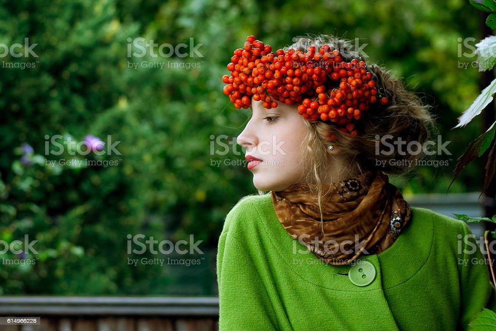 girl with a wreath on the head of rowan stock photo