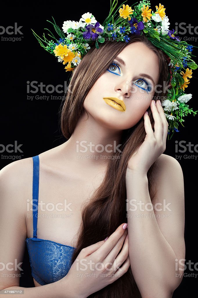 Girl with a wreath thought. stock photo