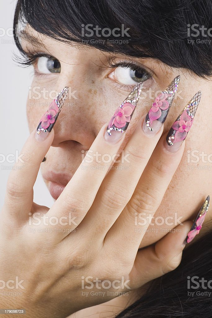 Girl with Acrylic Pink Flower Nails royalty-free stock photo