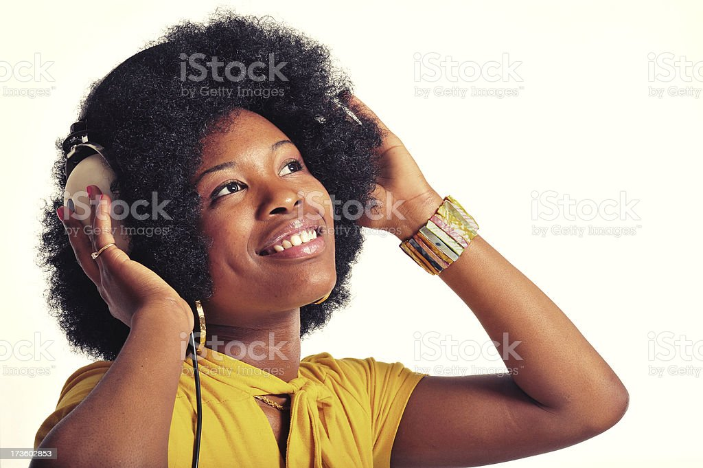 Girl with Afro and Headphones stock photo
