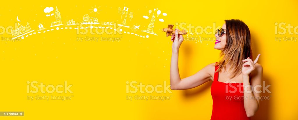 girl with airplane toy dreaming about attractions stock photo