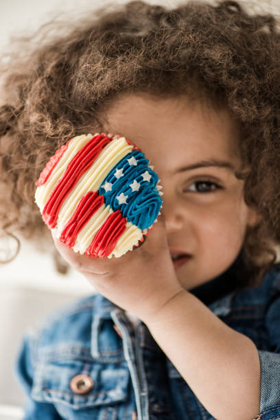 girl with american flag muffin stock photo