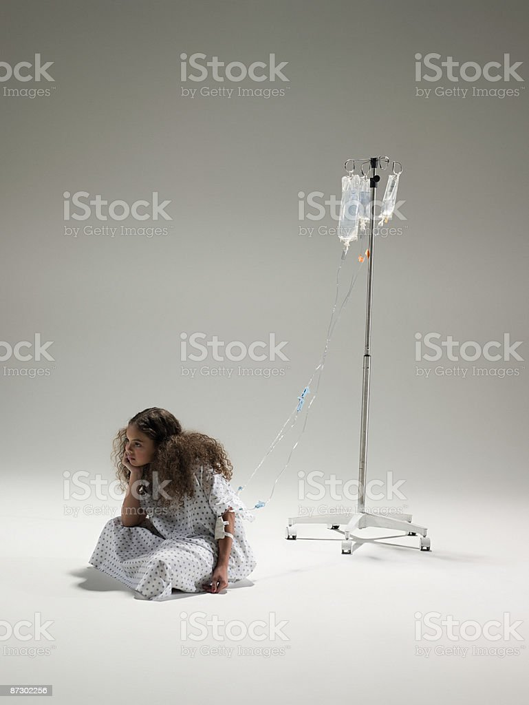 Girl with an intrvenous drip royalty-free stock photo