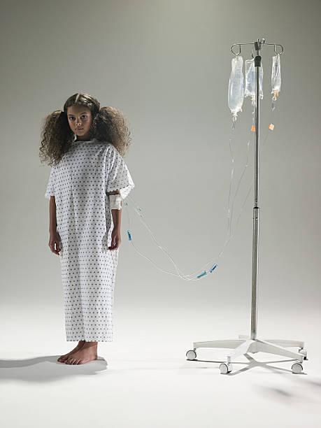 girl with an intrvenous drip - hospital studio bildbanksfoton och bilder