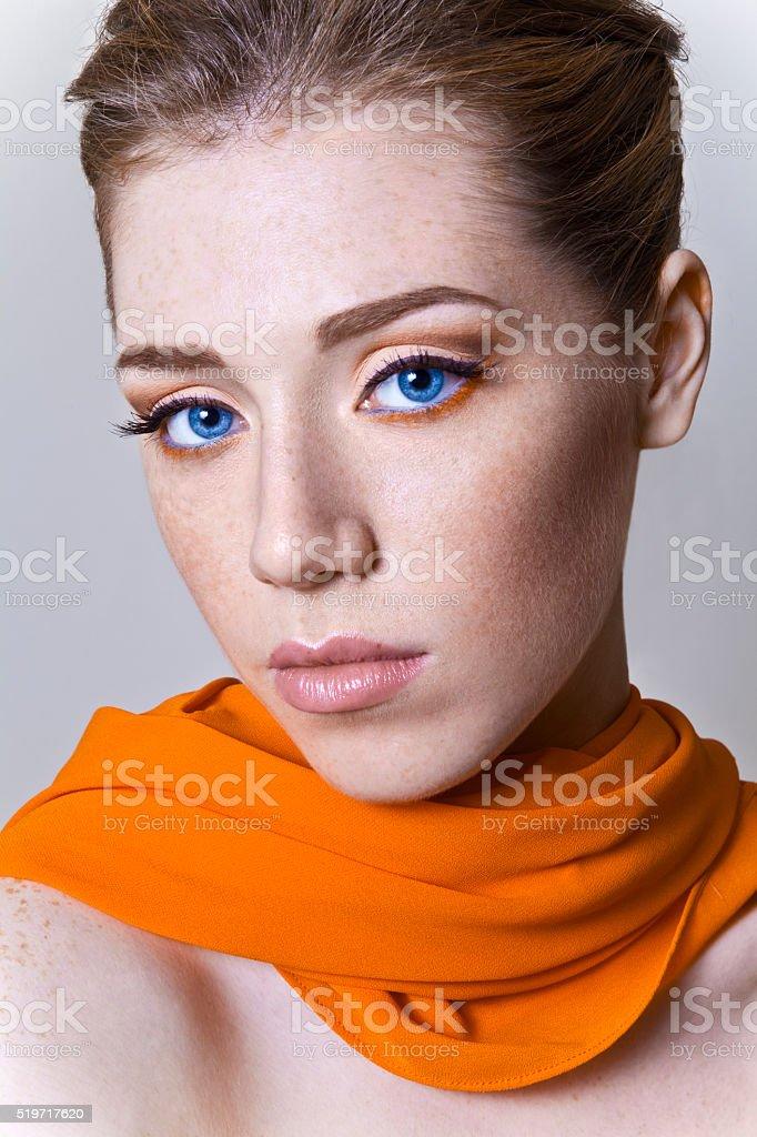 Girl with an orange scarf stock photo
