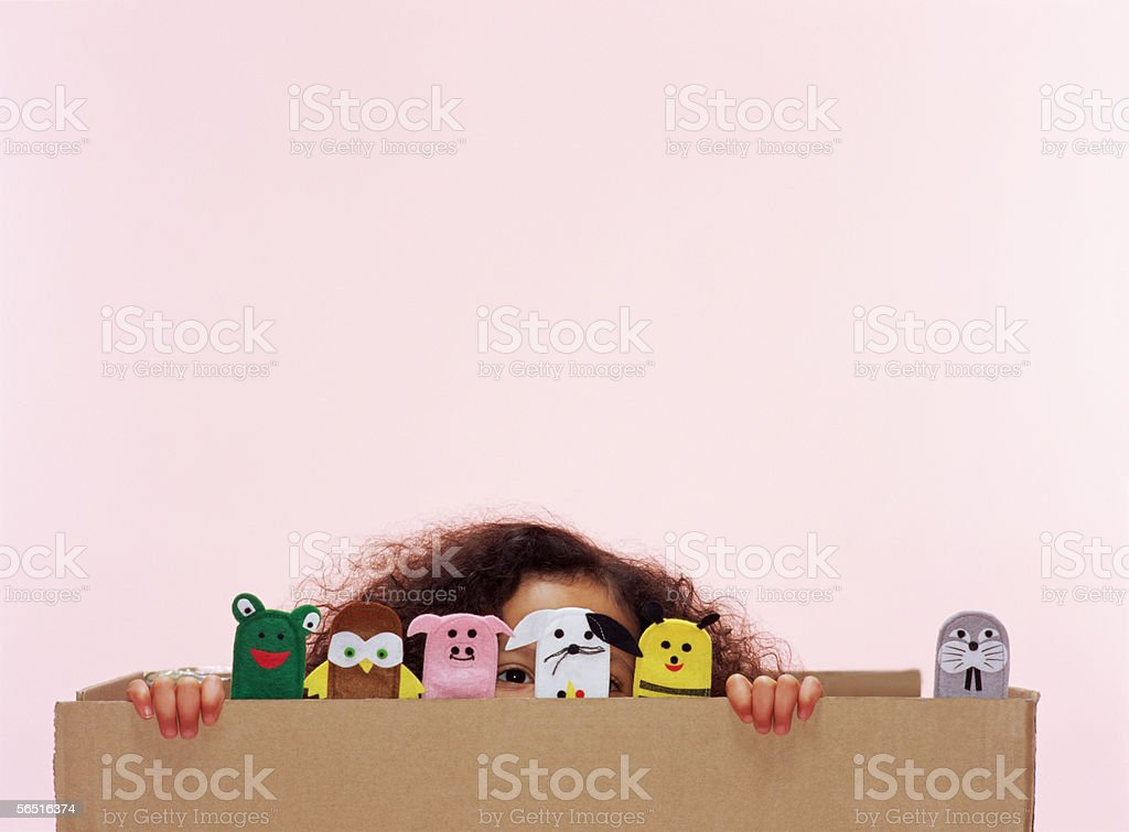Girl with animal finger puppets stock photo