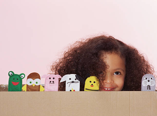 Girl with animal finger puppets  puppet stock pictures, royalty-free photos & images