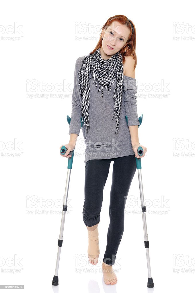 Girl with Ankle Bandage and Crutches royalty-free stock photo