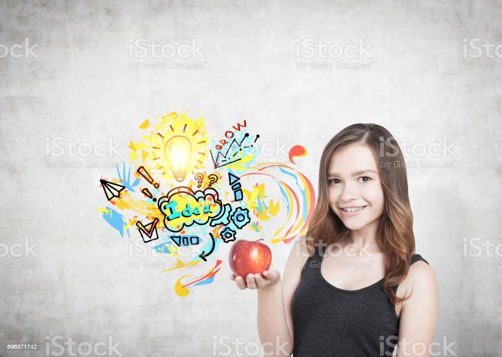 Girl with apple and nutrition idea stock photo