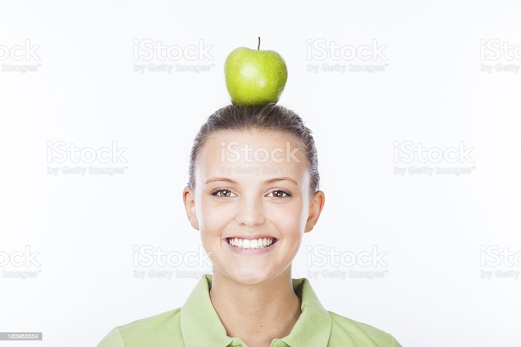Girl with apple on head royalty-free stock photo