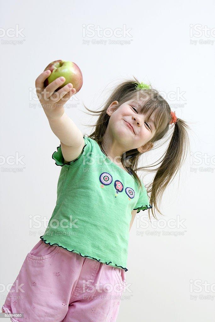 Chica con apple foto de stock libre de derechos