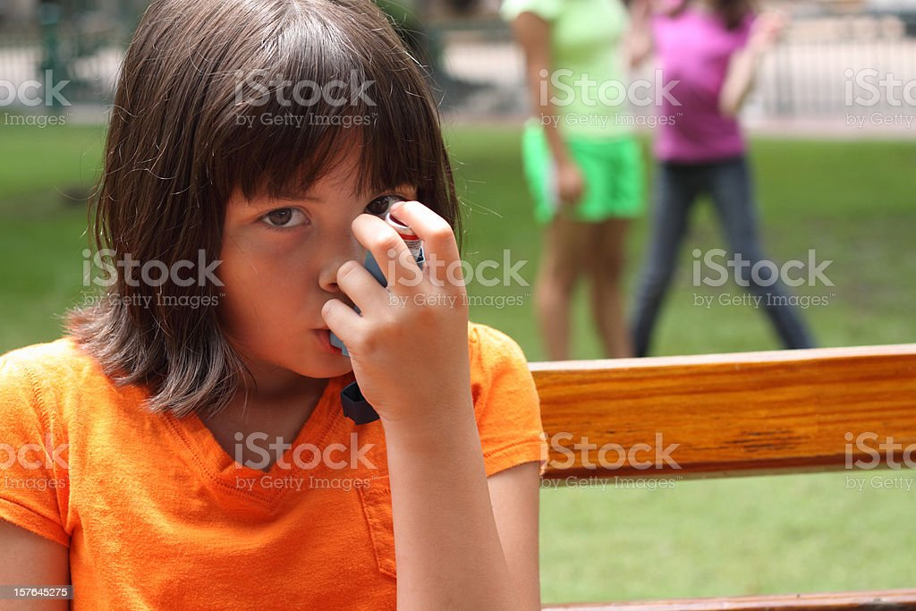Girl With Asthma stock photo