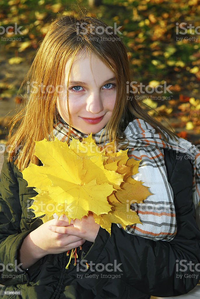 Girl with autumn leaves royalty-free stock photo