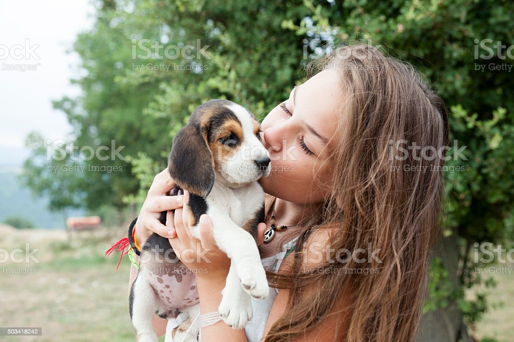 Girl with baby dog stock photo