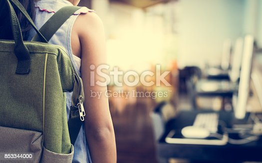 istock Girl with backpack entering to computer classroom. 853344000