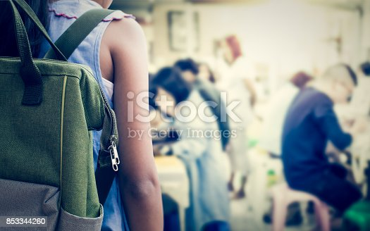 istock Girl with backpack entering to the art classroom. 853344260
