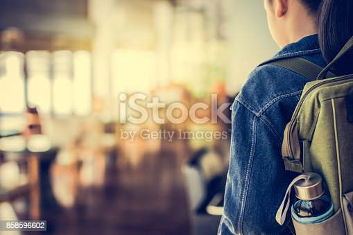 istock Girl with backpack entering to the classroom. 858596602