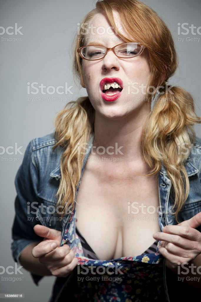 Girl with bad teeth and cleavage. stock photo