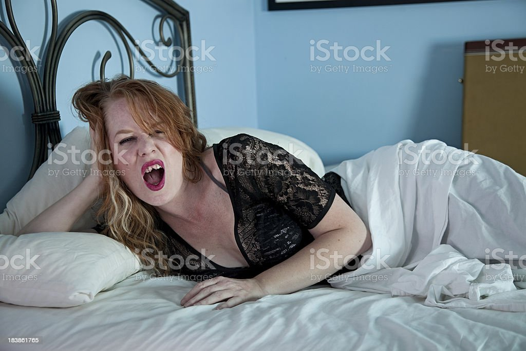 Girl with bad teeth and lingerie. stock photo