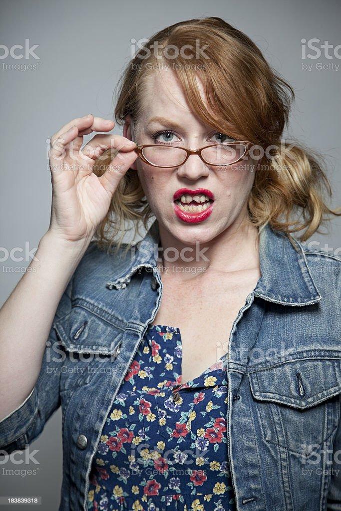 Girl with bad teeth giving incredulous look stock photo