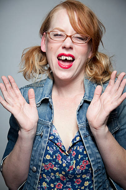 girl with bad teeth laughing - ugly girl stock photos and pictures